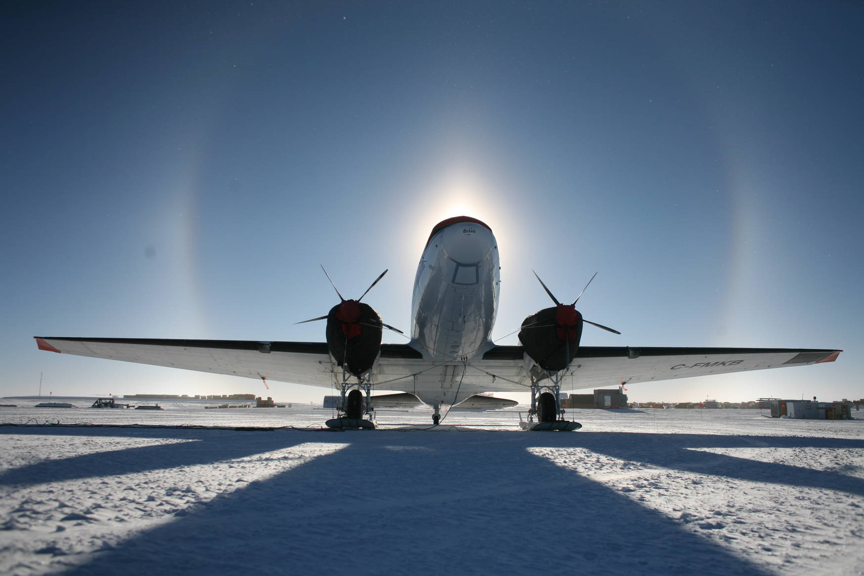 A Basler aircraft surrounded by a halo of the Sun.