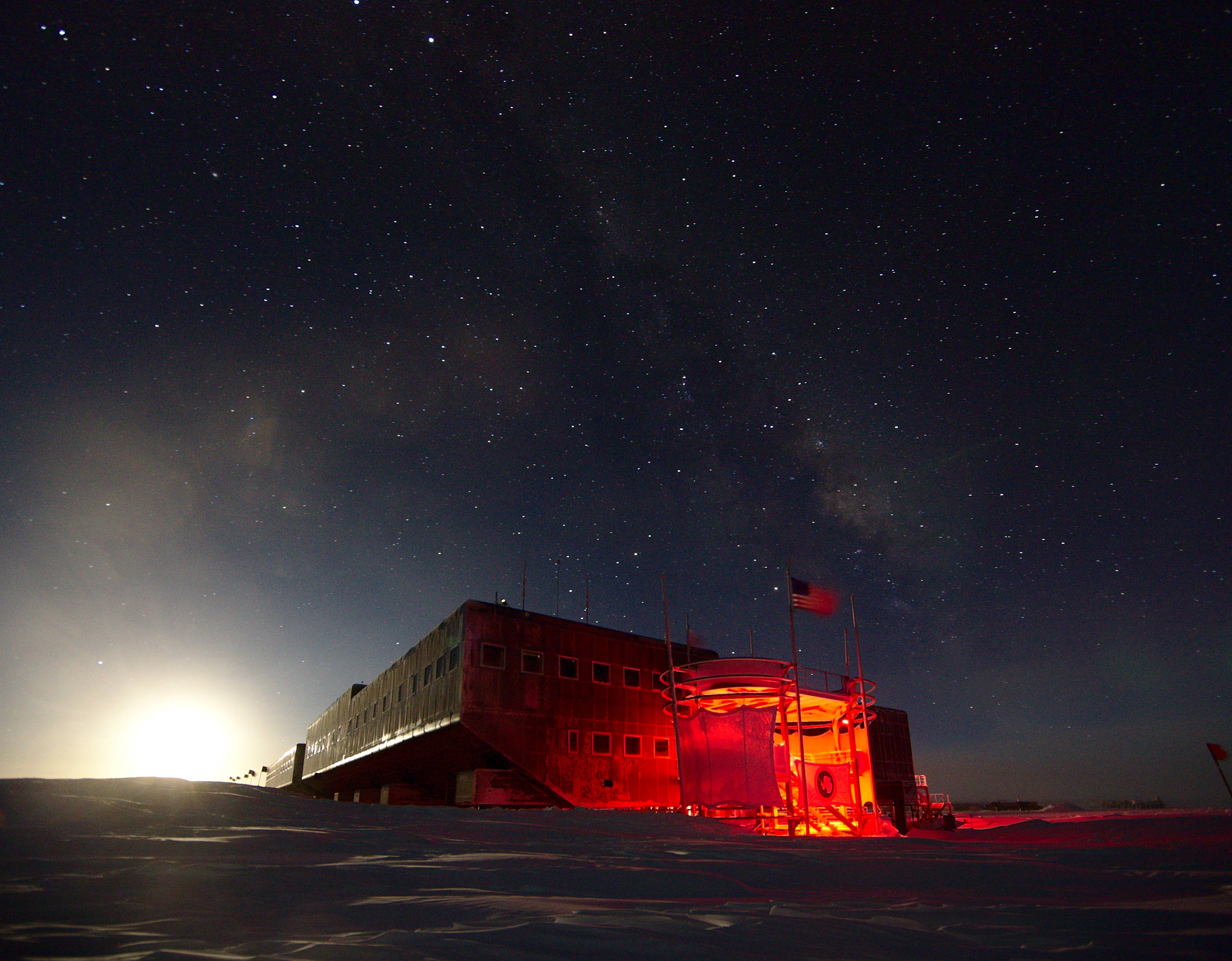 The entrance to the Amundsen-Scott research station. The bright light of the Moon illuminates the side of the station