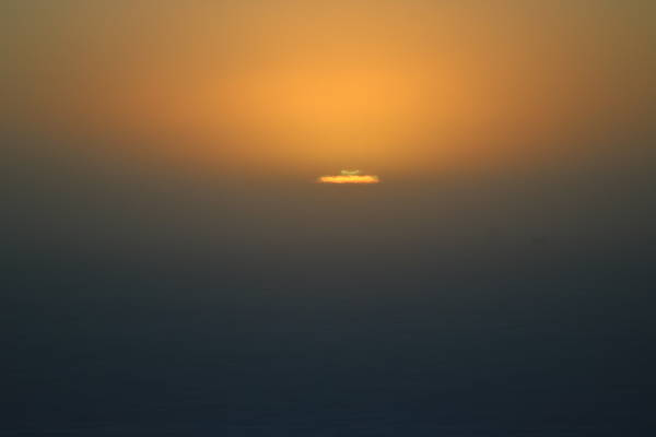 The green flash, an elusive light phenomena caused by the atmosphere, visible mostly in very flat surroundings. (Picture: G. Hall)
