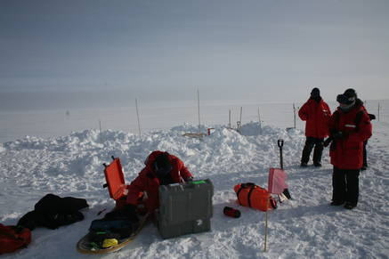 Working on the seismological detectors requires digging out holes with a shovel.