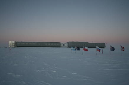 The ceremonial south pole and the south pole station during sunset (opposite of the sun).